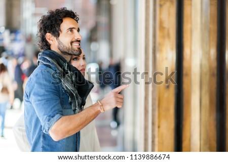 Couple shopping in an urban street #1139886674