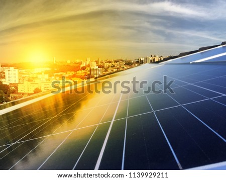 Photovoltaic power plant on the roof of a residential building on sunny day - Solar Energy concept of sustainable resources #1139929211