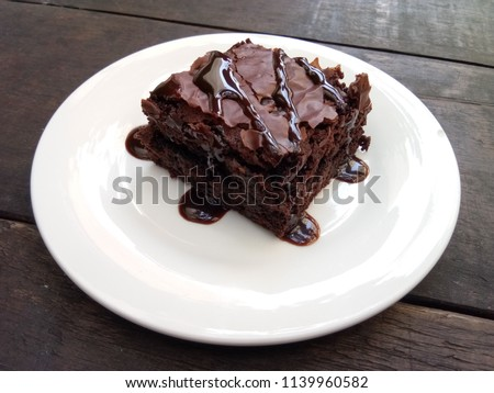 Delicious chocolate brownies on white plate. #1139960582