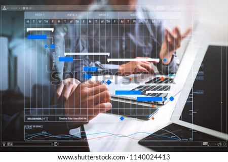 Project manager working and update tasks with milestones progress planning and Gantt chart scheduling virtual diagram.Business team meeting. Photo professional investor working new start up project. #1140024413