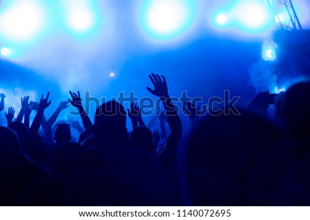 Hand fans during a concert #1140072695