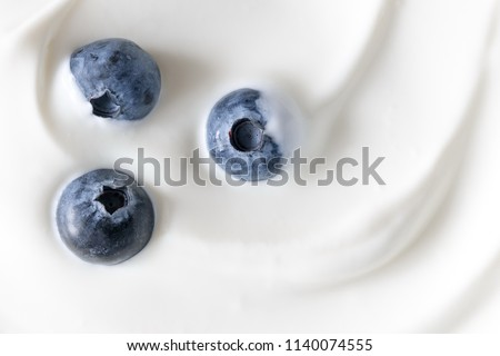 Yogurt and fresh berries blueberries, background. Flat lay, top view, copy space  #1140074555
