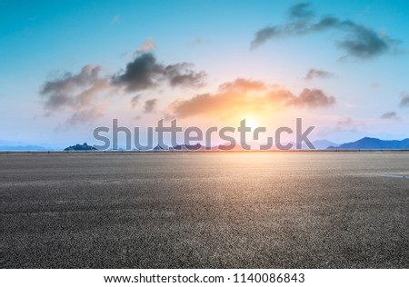 Empty asphalt road and great wall with mountains at sunset #1140086843