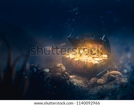 Open treasure chest sunken at the bottom of the sea / high contrast image #1140092966