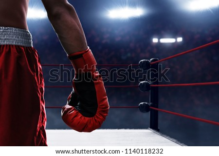 Red boxing glove Royalty-Free Stock Photo #1140118232