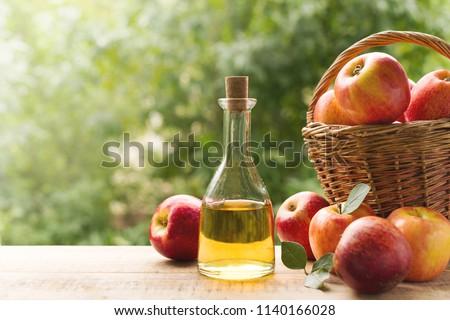 Apple cider vinegar in bottle with apple summer day #1140166028