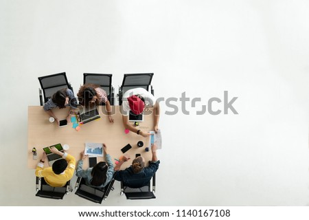 Top view of diverse people of creative team group using smartphone, mobile phone, tablet and computer laptop. Overhead view of asian young creative start up meeting. Have copy space for fill text. #1140167108