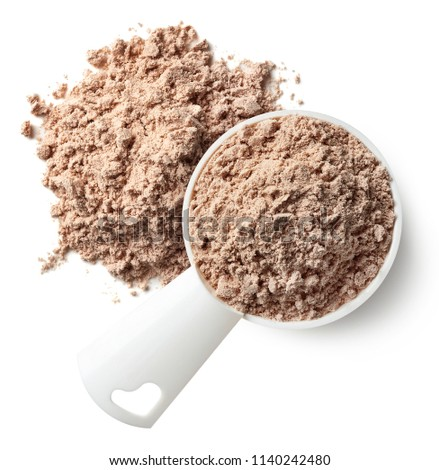 Plastic measuring spoon and heap of brown chocolate protein powder isolated on white background. Top view #1140242480