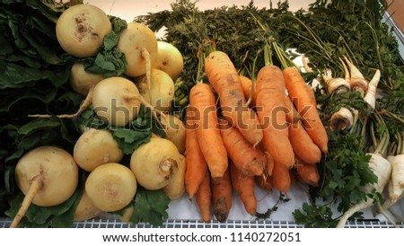 juicy root vegetables on the counter of the market #1140272051