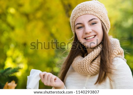 No ill no allergy. Woman throws out a handkerchief on autumn bac #1140293807