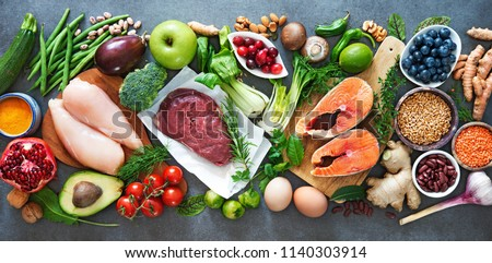 Balanced diet food background. Organic food for healthy nutrition, superfoods, meat, fish, legumes, nuts, seeds and greens  Royalty-Free Stock Photo #1140303914