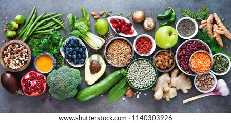 Healthy food selection with fruits, vegetables, seeds, superfood, cereals on gray background #1140303926