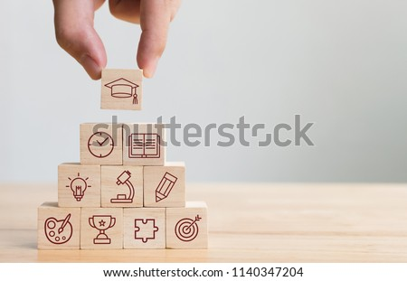 Hand arranging wood block stacking with elements education icon. Diagram of knowledge graduation concept #1140347204