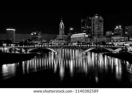 The Scioto River and Columbus skyline at night, in Columbus, Ohio.