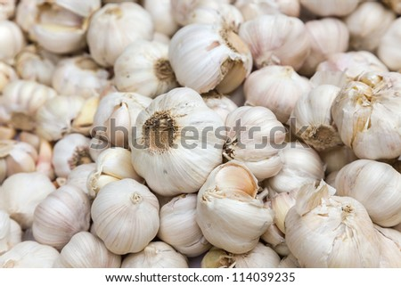 raw white garlic stacked in a local market, photo taken in south east China. #114039235