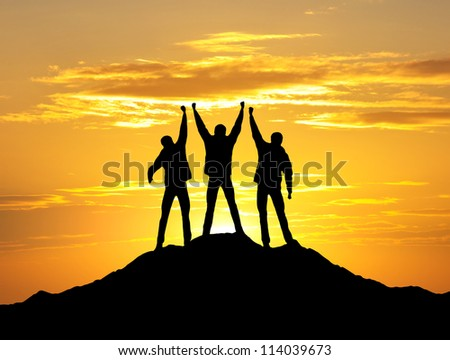 Silhouette of team on the top. Sport and active life #114039673