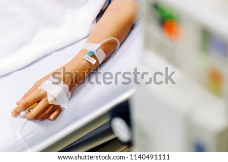 Close up image of IV drip in patient's hand in hospital. #1140491111