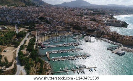 Aerial bird view picture beautiful Mediterranean coastline town and marina showing the bay and the mountain coast town and the marina filled with docked sea yachts beautiful azure blue colored ocean