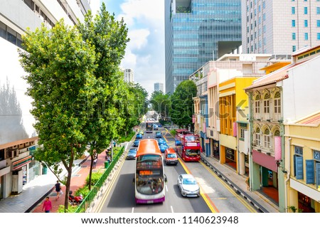 Elevated view of traffic on Singapore city street with modern colorful architecture #1140623948