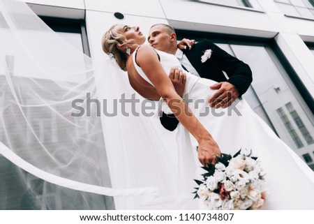 Wedding photo.Bride and groom.Sensual wedding photos.Embracing girl