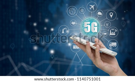5G network wireless systems and internet of things, Smart city and communication network with smartphone in hand and objects icon connecting together,  Connect global wireless devices. #1140751001