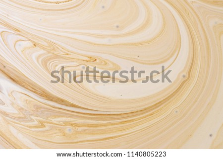 Close-up abstract caramel shapes latte art in coffee. Liquid texture background macro. #1140805223