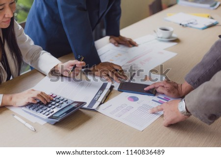 Business team meeting present.professional investor working with new startup project. Finance managers task.Digital tablet laptop computer design smart phone  calculator #1140836489