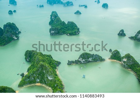 Ha Long Bay, in the Gulf of Tonkin, includes some 1,600 islands and islets, forming a spectacular seascape of limestone pillars. Because of their precipitous nature, most of the islands are uninhabite #1140883493