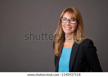 Close-up of a financial advisor businesswoman standing at isolated background. #1140937118