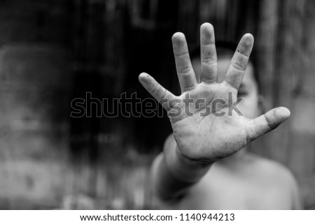 Stop, Child standing with outstretched hand showing stop, Violence concept. #1140944213