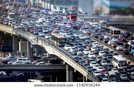 Abstract, blur, bokeh background, defocusing - image for the background. Аutomobile congestion in the morning rush hour Royalty-Free Stock Photo #1140958244