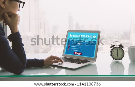 Insurance concept. Women use laptops to search for insurance online on a home office. #1141108736