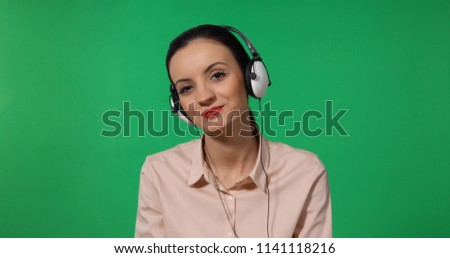 Happy Business Woman Listening Music Using Headphones Entertainment Activity With Green Screen Background