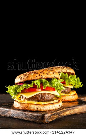 Delicious grilled burgers #1141224347