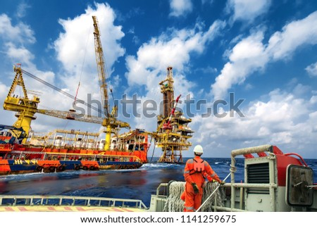 Technician or worker on the crew boat during transfer to platform or drilling rig  in process oil and gas platform offshore,technician #1141259675