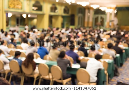 Abstract blurred photo background of business people in conference hall or seminar room. Bokeh business meeting conference training learning coaching concept. #1141347062