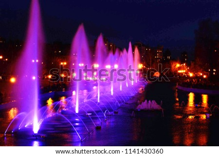 bright purple fountains in the night #1141430360