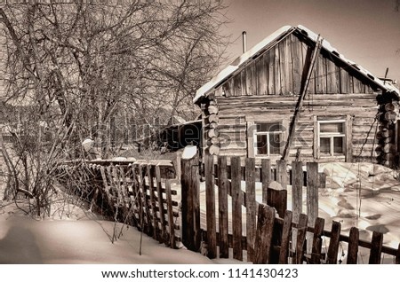 a house with a wooden fence #1141430423
