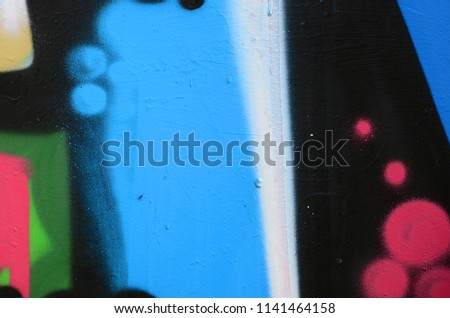 Street art. Abstract background image of a fragment of a colored graffiti painting in blue tones #1141464158