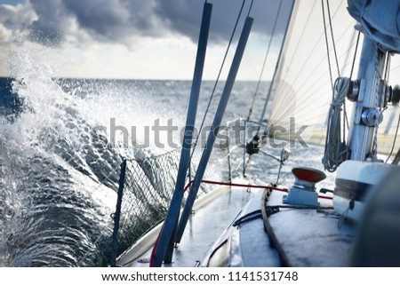 Stormy weather on the sea. A view from the sailboat's deck to the bow, Norway #1141531748