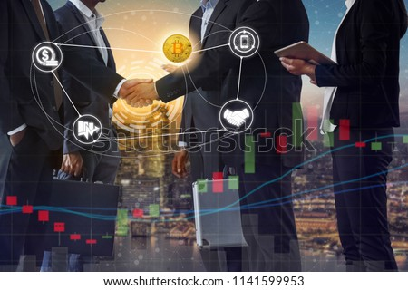 Bitcoin (BTC) and cryptocurrency payment acceptance concept - Businessman handshaking showing accepted payment by using Bitcoin. Blockchain and financial technology. #1141599953
