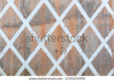 Diamond pattern on a concrete wall with texture. #1141614446