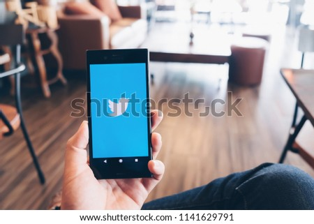 "CHIANGMAI, THAILAND -July 07,2018:sony mobile shone open Twitter app.Twitter is an online social networking and microblogging service that enables users to send and read ""tweets"". #1141629791"