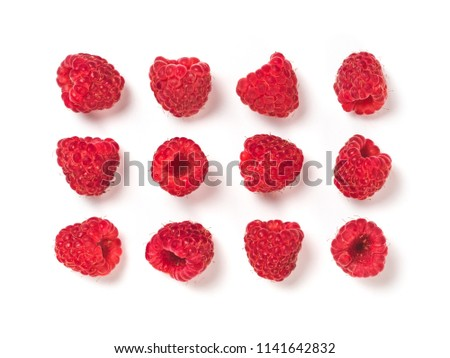View from above of ripe red raspberry on white background. Organic raspberries creative layout pattern, isolated on white with clipping path. Top view or flat lay. Vegan food concept #1141642832