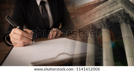 legislation law legal concept. lawyer signing legal document and agreement with court background. wide view. #1141652006