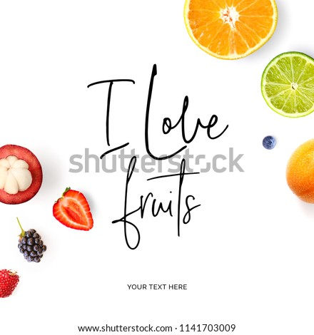 """Creative layout made of  quote """"I love fruits"""".  Tropical flat lay. Food concept. Orange, lime, strawberry, blueberry, blackberry and mangosteen on the white background. #1141703009"""