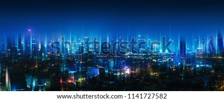 Wireless network and Connection technology concept with Bangkok city background at night in Thailand, panorama view Royalty-Free Stock Photo #1141727582
