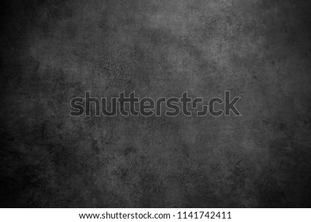 abstract black background with rough distressed aged texture, grunge charcoal gray color background for vintage style cards or web backgrounds or brochure backdrop for ads or other graphic art images #1141742411