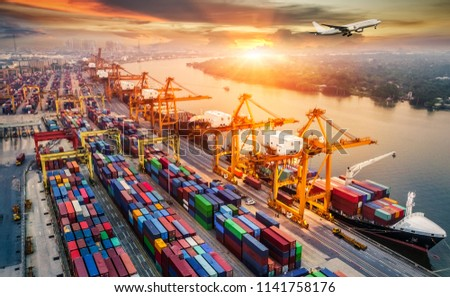 Logistics and transportation of Container Cargo ship and Cargo plane with working crane bridge in shipyard at sunrise, logistic import export and transport industry background #1141758176