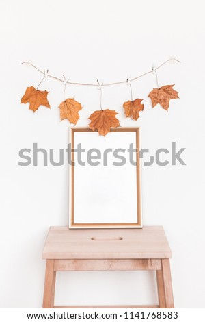 Autumn composition. Photo frame, autumn garland on white background. Front view, copy space